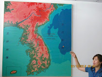 Our Sr Guide, Pang, and map of the two Koreas with DMZ between them at the 38th Parallel.