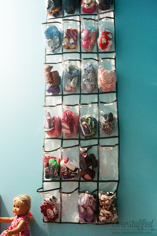 Great idea for American Girl Doll clothes! Organize the outfits with an over the door shoe organizer!