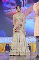 Actress Rakul Preet Singh Stills in Golden Embroidery saree at Rarandoi Veduka Chuddam Audio Launch .COM 0009.jpg