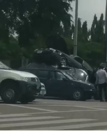 [VIDEO] 3 Cars On High Speed Somersault On Top Of Each Other At Wuse Market, Abuja
