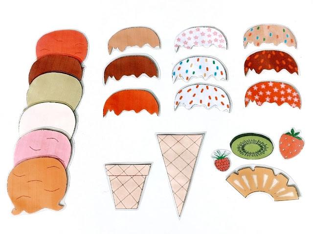 na zdjęciu wydrukowane i zalaminowane lody, polewy i owoce, rozłożone na stole