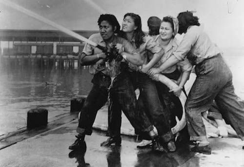 Photo of women wielding firehose, Pearl Harbor, WWII