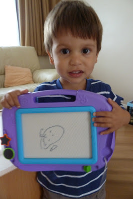 Child's first drawing of a face