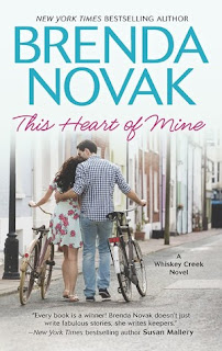 Cover Description: a man and a woman walk their bikes next to each other while embracing.