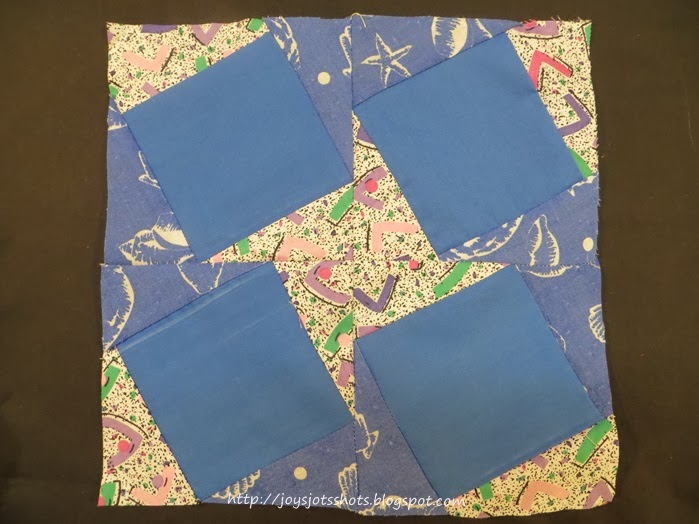 http://joysjotsshots.blogspot.com/2014/01/quilt-shot-block-14-happy-new-year.html