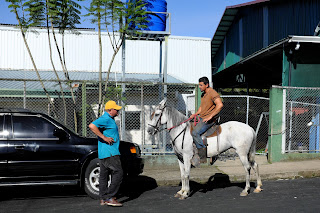 Man on horse on street in Puriscal