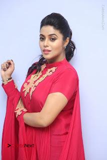 Actress Poorna Latest Stills in Red Dress at Rakshasi First Look Launch  0130.JPG