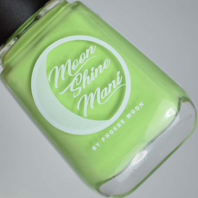 green nail polish in a bottle