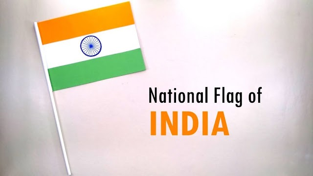 Why was the Ashoka Chakra placed in the tricolor flag instead of the spinning wheel?