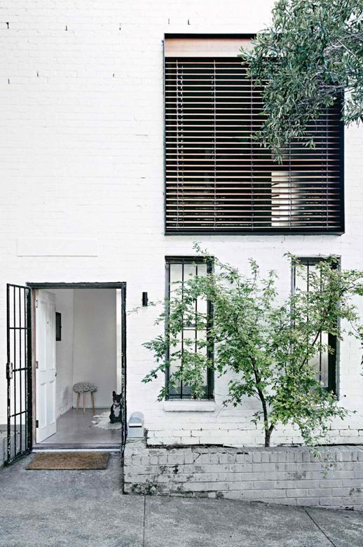 fachada casa con un interior de inspiración industrial chicanddeco
