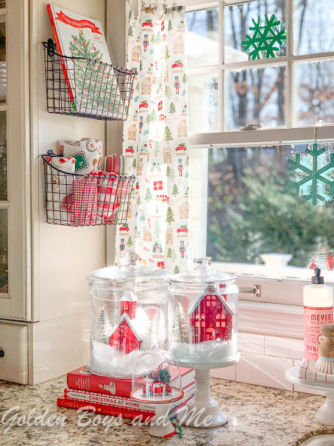 Christmas kitchen with wire storage baskets and village in glass jars - www.goldenboysandme.com