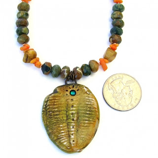 trilobite necklace with rhyolite and coral.