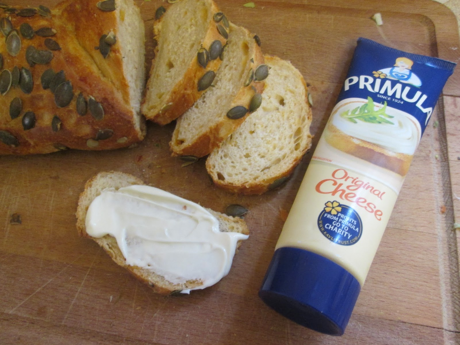Primula original cheese spread with red Leicester and pumpkin seed bread