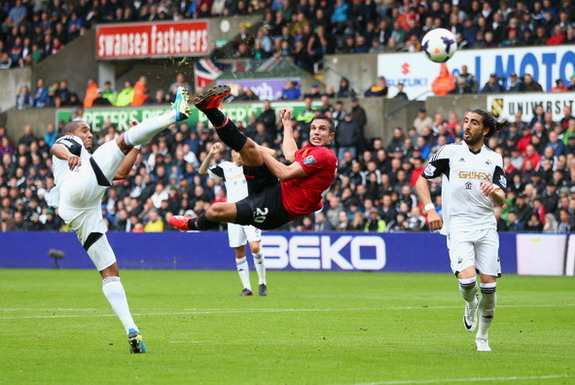Manchester United player Robin van Persie scores the opening goal against Swansea