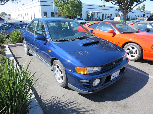 Subaru Impreza with overall paint job from Almost Everything Auto Body.