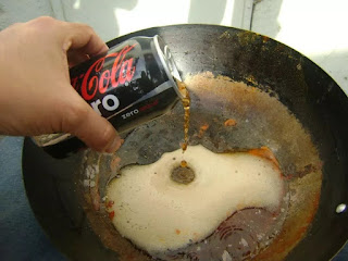 Coca-Cola and a burnt pan