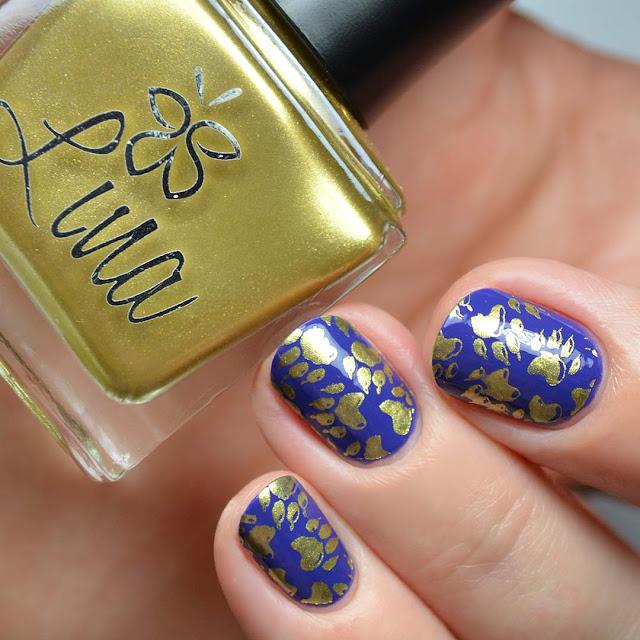 gold paw print nail art