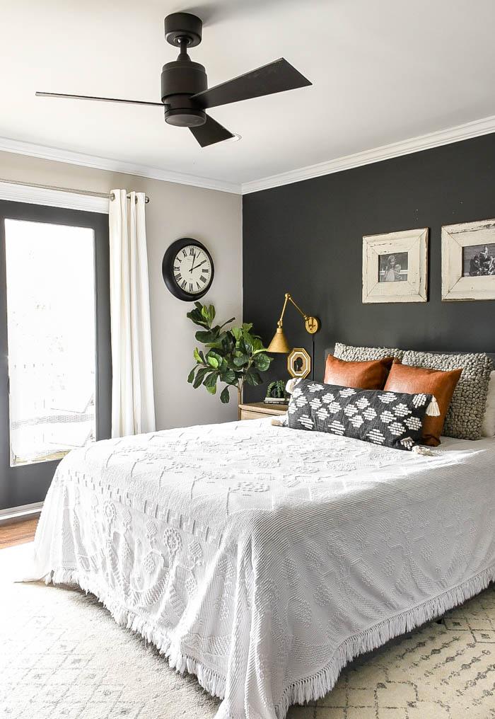 Vintage modern, high-contrast master bedroom