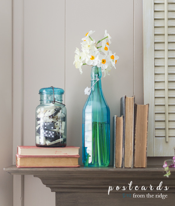 vintage blue mason jar with dominoes and blue bottle with narcissus