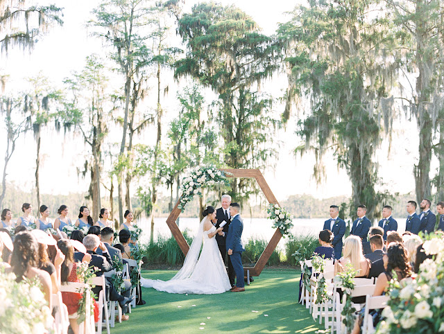 wedding ceremony at isleworth country club hexagon arch