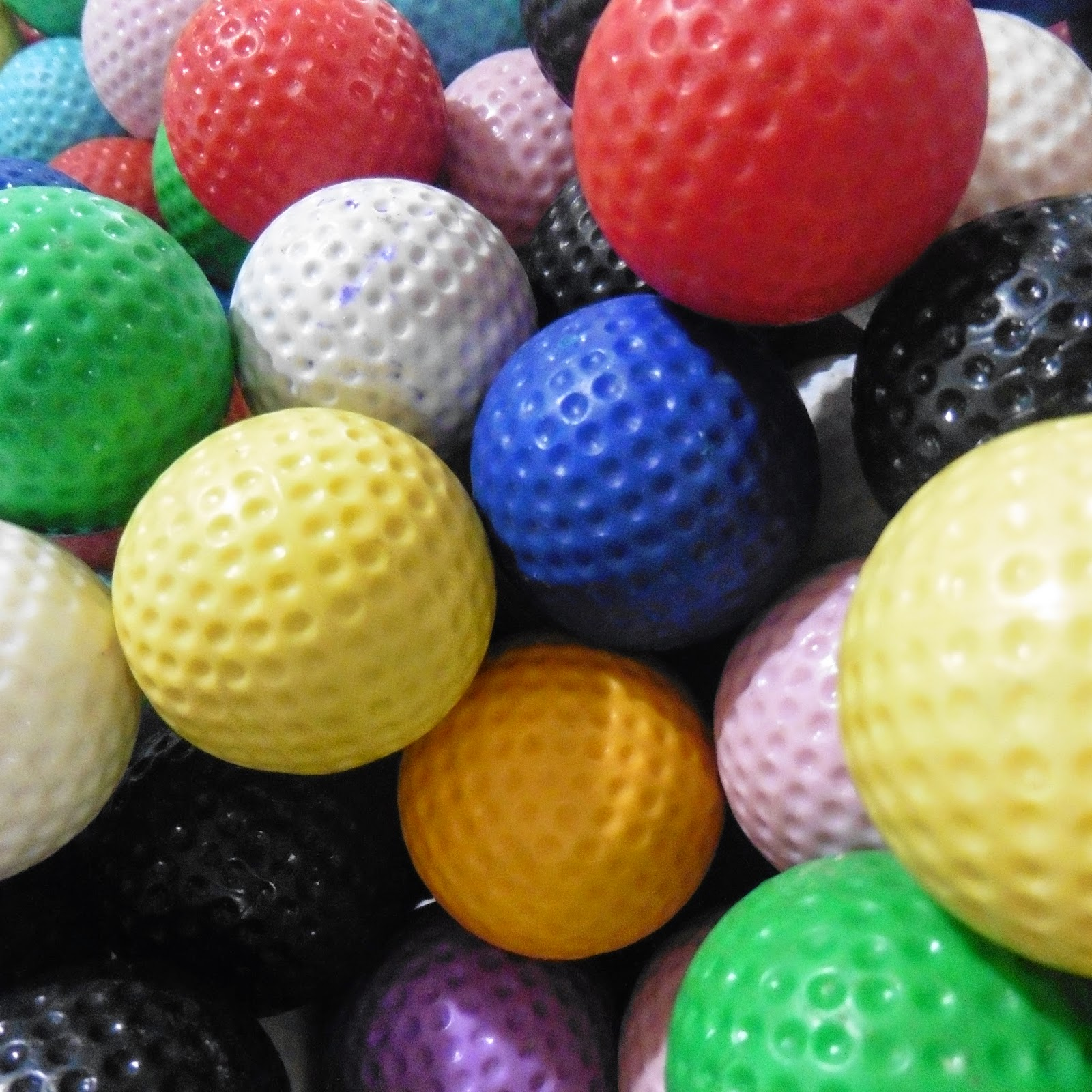 Colourful golf balls