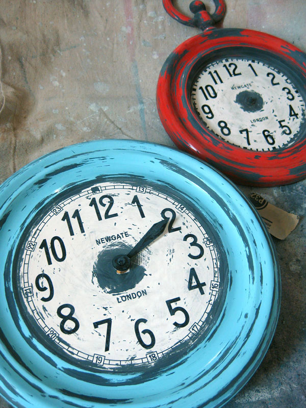 red and blue clocks painted and sanded to look old