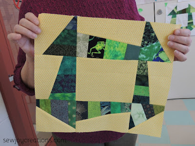 yellow background scrappy greens frog fabric liberated churn dash block