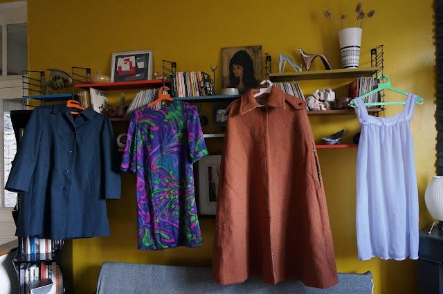 un imper en tergal , une robe en laine, une cape en laine et une nuisette en plumetis   1970s navy raincoat , psychedelic woolen dress , rust cape, 1960s dotted swiss babydoll 60s 70s annees 60 70