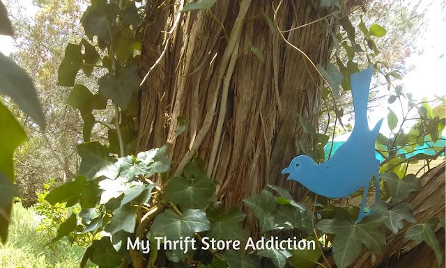 thrift store candle sconce bird feeder