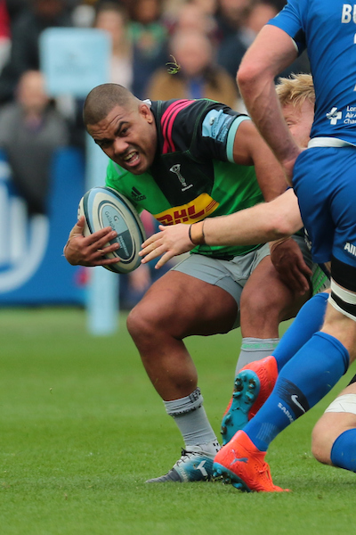 Kyle Sinckler of Harlequins carries the ball