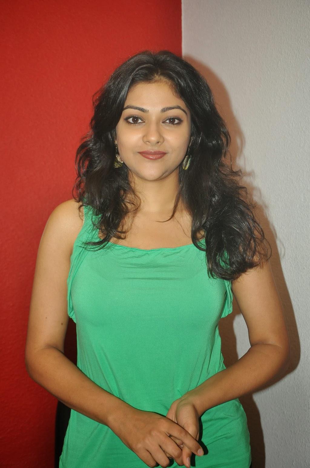 Abhirami photos in green sleeveless top