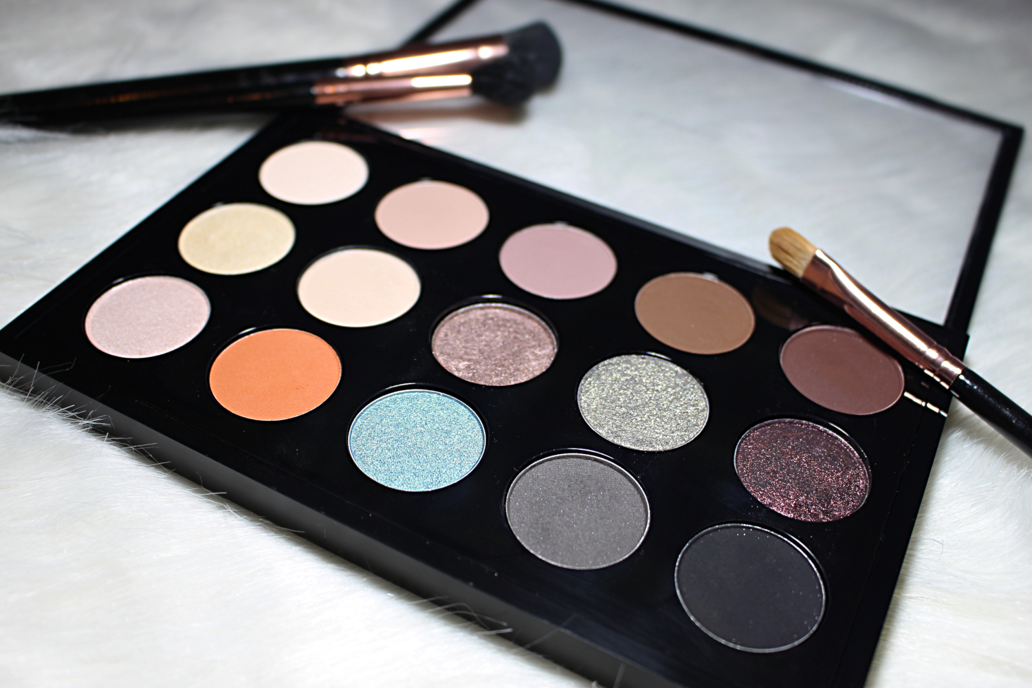 mac eyeshadow pro palette filled with eyeshadow pans