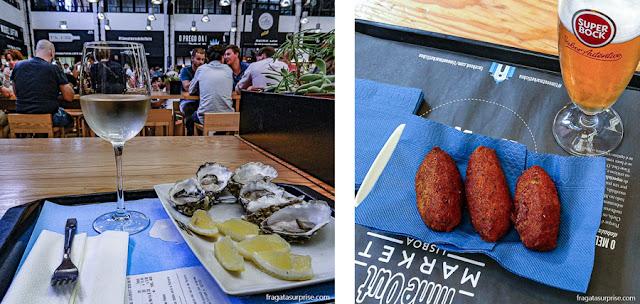 Bolinhos de bacalhau do Olhó Bacalhau e ostras do Sea Me, no Mercado da Ribeira, em Lisboa