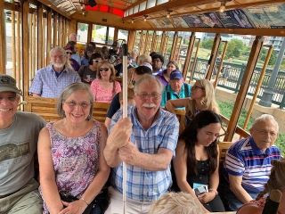 Blind seniors enjoy seasonal open-air trolley offering scenic rides along the South Platte Greenway & Downtown Denver.