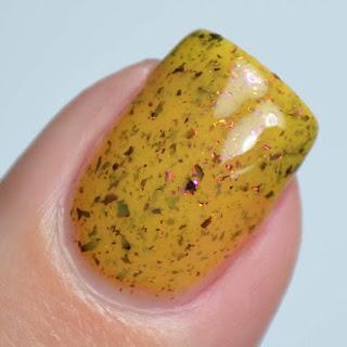 yellow nail polish with flakies