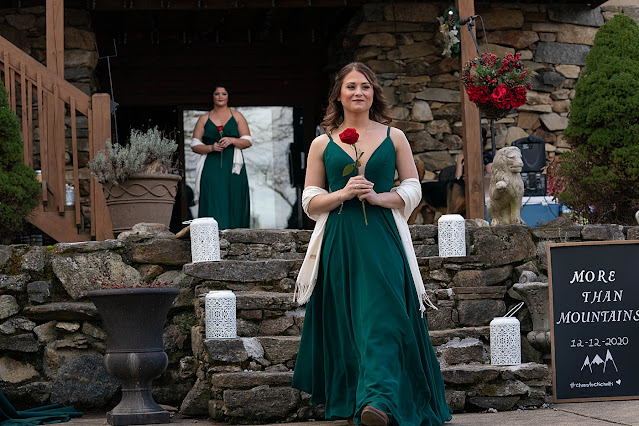 Ceremony Bridesmaids coming in holding red roses Magnolia Farm Asheville Wedding Photography captured by Houghton Photography