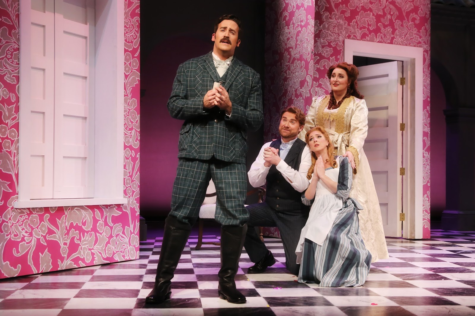 IN PERFORMANCE: (from left to right) Baritone STEVEN LaBRIE as Conte Almaviva, bass-baritone TYLER SIMPSON as Figaro, and sopranos JENNIFER CHEREST and D'ANA LOMBARD as Susanna and Contessa Almaviva in North Carolina Opera's production of Wolfgang Amadeus Mozart's LE NOZZE DI FIGARO, February 2017 [Photo by Curtis Brown Photography, © by North Carolina Opera]