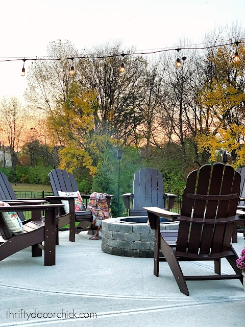 Circle fire pit with chairs on patio