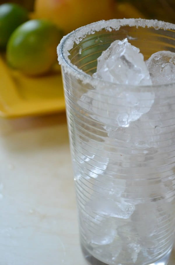 Fill Glass with ice for Pink Grapefruit Margarita Recipe.