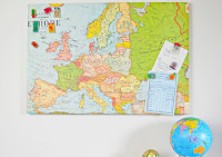http://www.pillarboxblue.com/upcycled-map-magnetic-board/