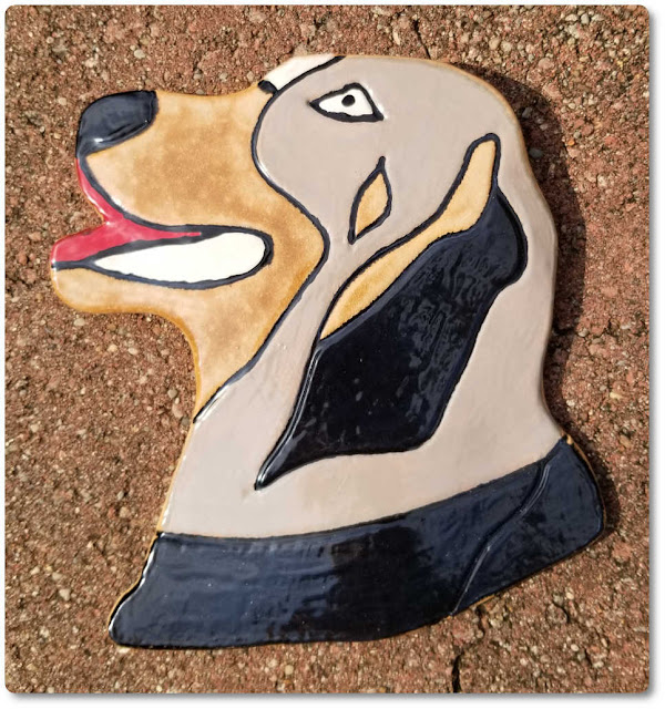 Ceramic dog themed wall decoration