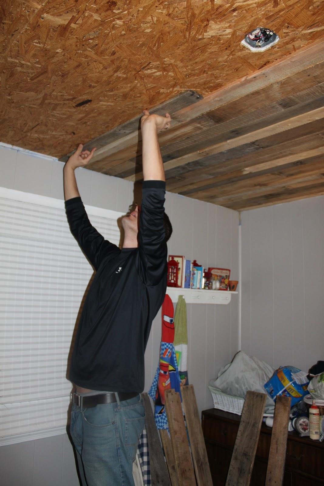 basement wood ceiling.  Remodelaholic Rustic Pallet Wood Ceiling Tutorial