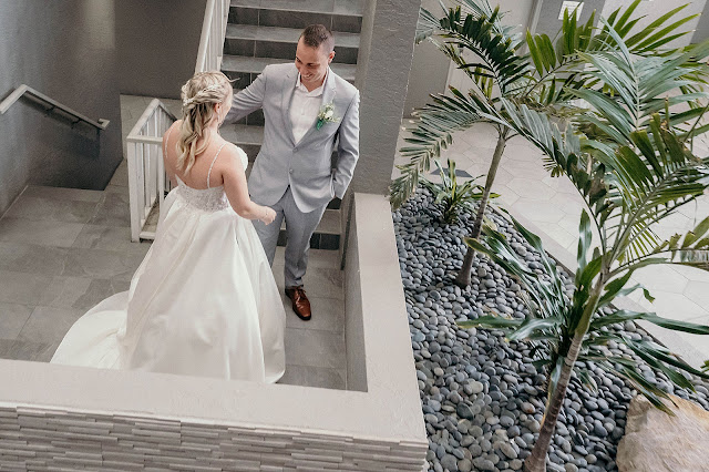 Bride and Groom first look on spiral staircase