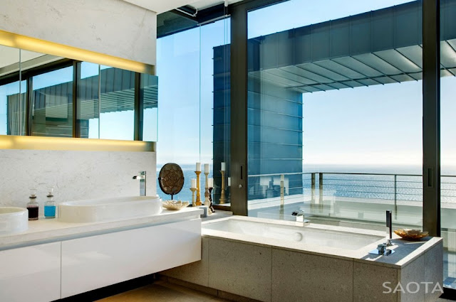 Picture of modern furniture by the window in the bathroom with the ocean view