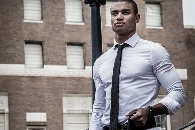 Dark skin tone guy in perfect fit shirt.