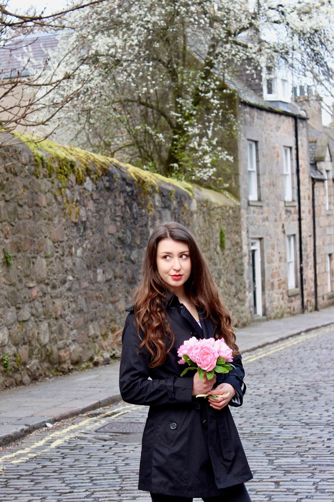 Girl with roses in old town Aberdeen