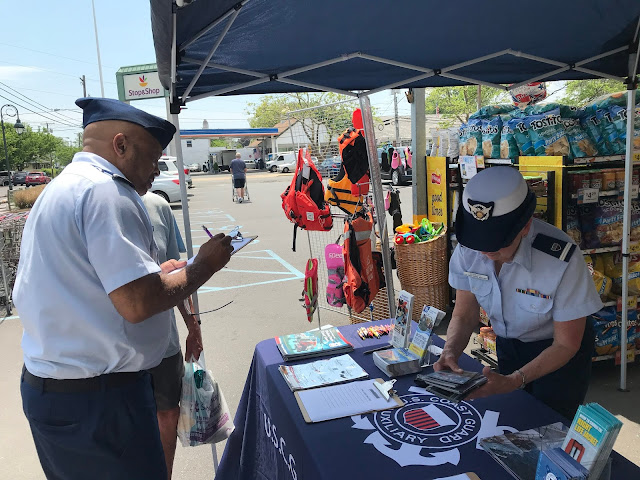 Auxiliarists David Witherspoon (left) and Alyce Schroth signed up members of the public for a boating safety class and took questions about life jackets and joining the US Coast Guard Auxiliary