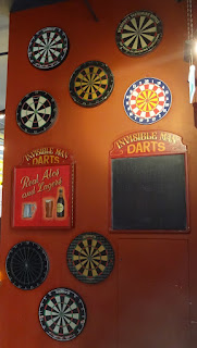 There's a wall of dart boards at Flight Club. No Quadro board though