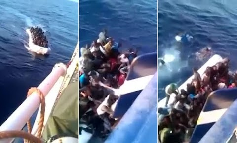 Migrants sink their own boat after crashing it into the side of a Tunisian fishing trawler they mistook for the coast guard .