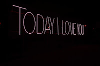 Red neon sign on a black backdrop reading, Today I Love You
